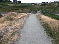Dumyat hill run. Through the gate and back onto tarmac