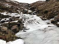 Glens Kendrum and Ogle. A well frozen ford