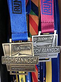 Loch Rannoch Marathon. The marathon medal with the image of Schiehallion on it