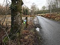 Killin - Lochan Breaclaich. The Rob Roy way marker on the main road pointing the way