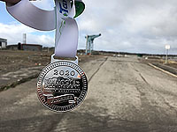 Balloch to Clydebank half. Finisher medal with the Titan crane in the background