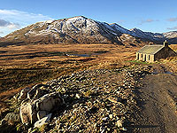 To Carn Labhruinn. The isolated cottage